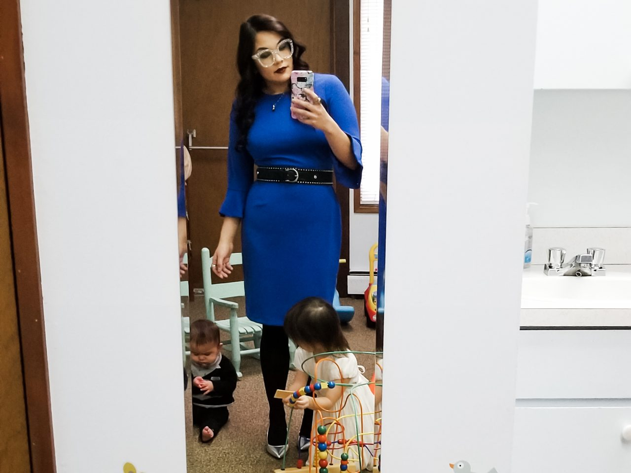 Rebecca Jones-Howe in a church playroom with her children.