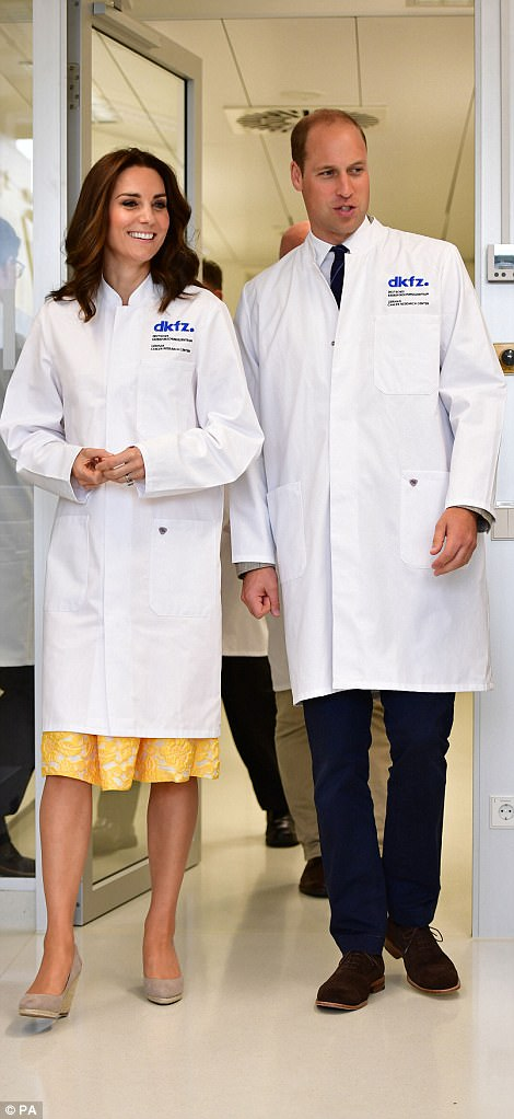 42834A2E00000578-4713936-She_later_donned_a_white_lab_coat_for_a_visit_to_the_German_Canc-a-83_1500569110349.jpg