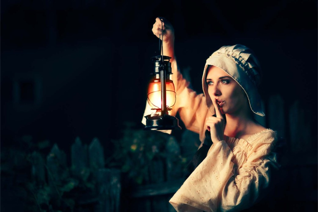 Medieval Woman with the Finger on the Lips Holding a Lamp