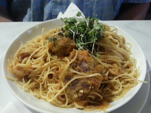 This plate features angel hair pasta (by special request) and meatballs with a simple, tomato-based, slow simmering sauce even Italy natives could appreciate. Topped off with sprouts.