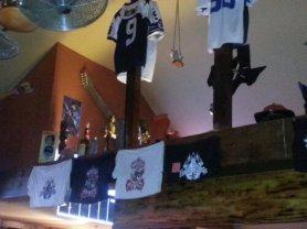 A combination of Dallas Cowboys paraphenalia and trophys decorate the indoor beams.