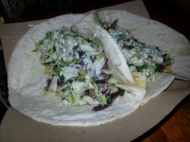 The Mahi-mahi fish tacos are served with a Lonestar coleslaw and jalapeno aioli, tucked inside a soft tortilla shell.
