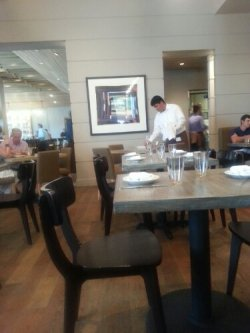 Seating includes tables and booths, in addition to private dining.