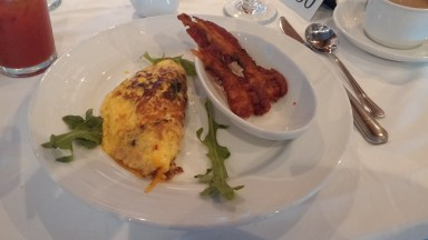 A made to order omelet with crispy bacon.