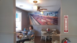 Boxcar wall art fills the dining room.