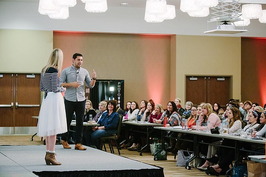Reset attendees listen to keynote speakers Amy & Jordan Demos