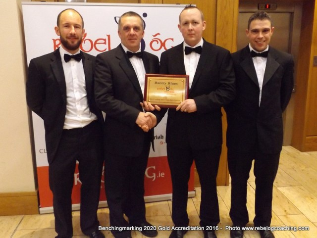 Benchmarking 2020 Mark O'Donovan from Bantry Blues GAA Club accepting the Gold Accreditation 2016 Benchmarking 2020 Award from GDA James McCarthy with Kevin O'Donovan Coaching Officer & Kevin O Callaghan Games Manager.