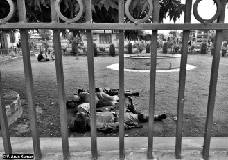Paramilitary soldiers taking rest inside University of Kashmir campus. The campus is patrolled round the clock by militarty. (Location: University of Kashmir, Srinagar)