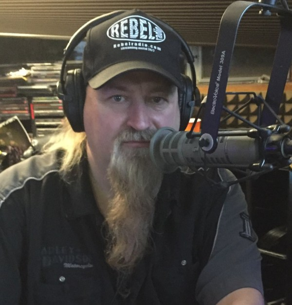 Scott Davidson wearing a Rebel Radio baseball cap