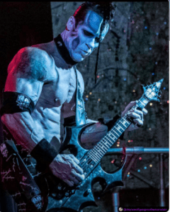 Doyle playing guitar in blue light