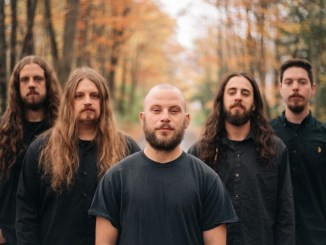 Rivers of Nihil standing in the woods during the fall/autumn