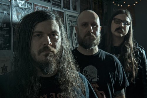 Fister band members, 3 men with beards, 2 with long hair, one bald