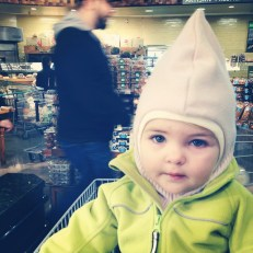 Dena from http://bikemamadelphia.com has her daughter in a balaclava for grocery shopping!