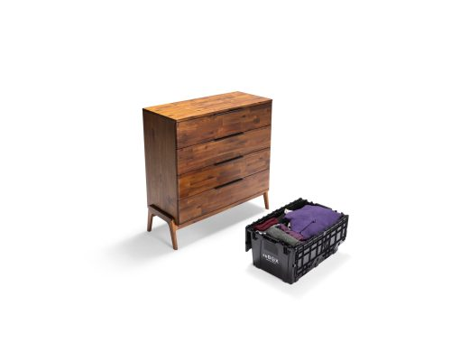 recycled plastic moving box is packed with bedroom dresser contents