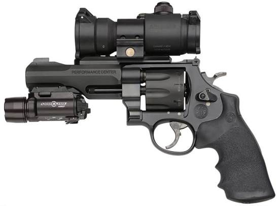 A escolha da arma de fogo.