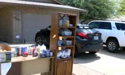'Giving Bookshelf' family sets up in yard to share supplies during COVID: 'We're going to be OK'