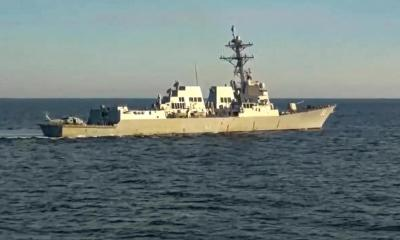 Russia says it pushed US destroyer from area near its waters