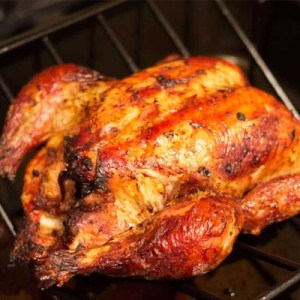 Pollo a la brasa peruano en caja china