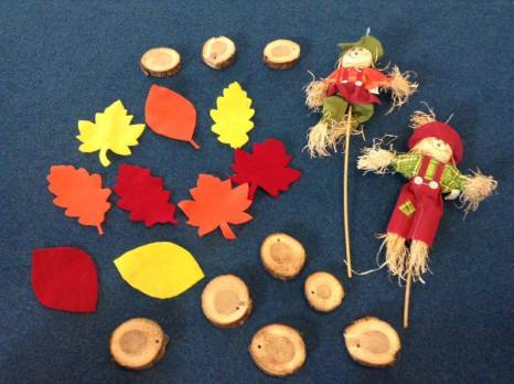 More multi-use props - the felt leaves and wood cookies usually used for moving over/on/between and the scarecrows used for holding while on beam or doing other balance skills!