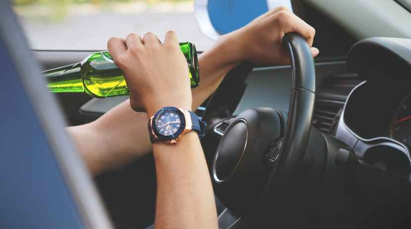 person driving and drinking