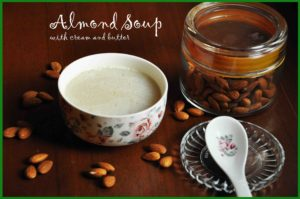 almond soup in bowl with jar of almond in the background