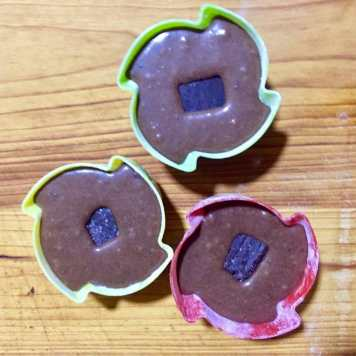 Pour in mold, add chocolate cube