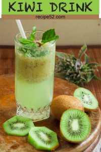 Kiwi juice drink served in a tall glass with kiwi slices around it.