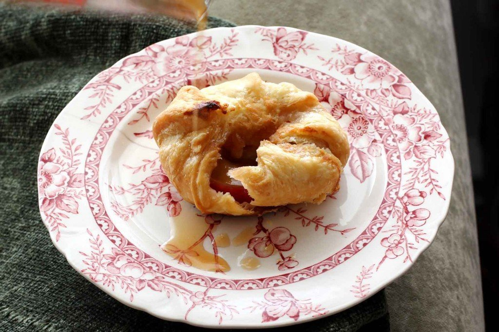 poached apple pie pockets with spiced apple cider sauce