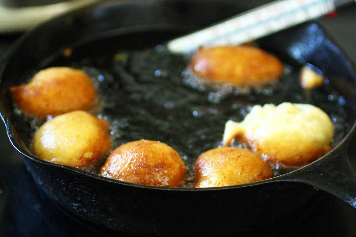 Banana Cardamom Fritters being fried