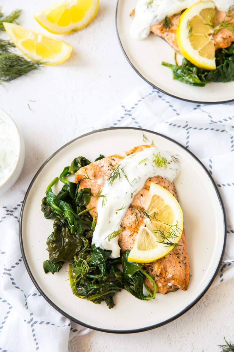 serving of Grilled Salmon with Spinach and Yogurt Dill Sauce