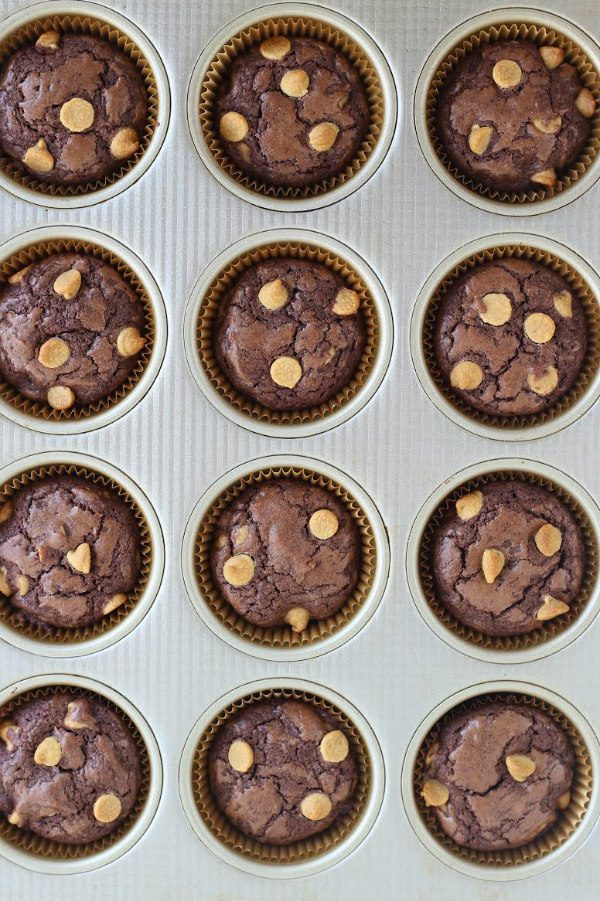 peanut butter chip brownie cupcakes in a muffin pan