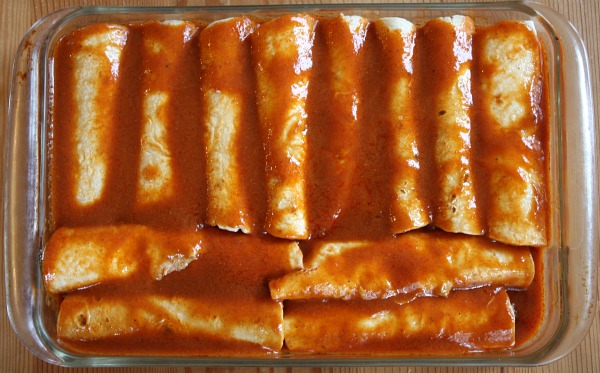 beef enchiladas in a casserole dish ready for the oven