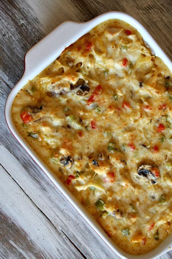 Chicken Spaghetti Casserole baked in a white casserole dish