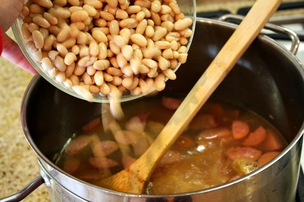 adding beans to soup