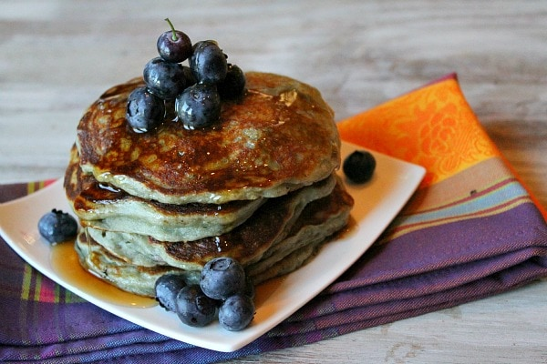 stack of blueberry Greek Yogurt Pancakes with syrup
