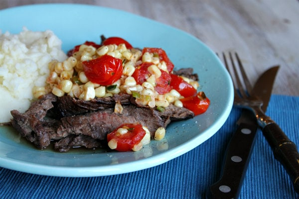 Grilled Skirt Steak with Corn and Cherry Tomato Salad recipe from RecipeGirl.com