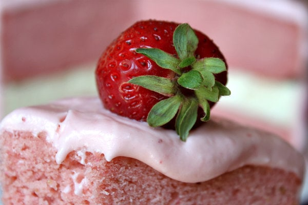 Strawberry Cheesecake Cake with a strawberry on top