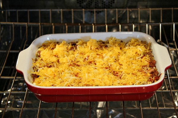 Adding cheese to Beef and Bean Enchilada Casserole