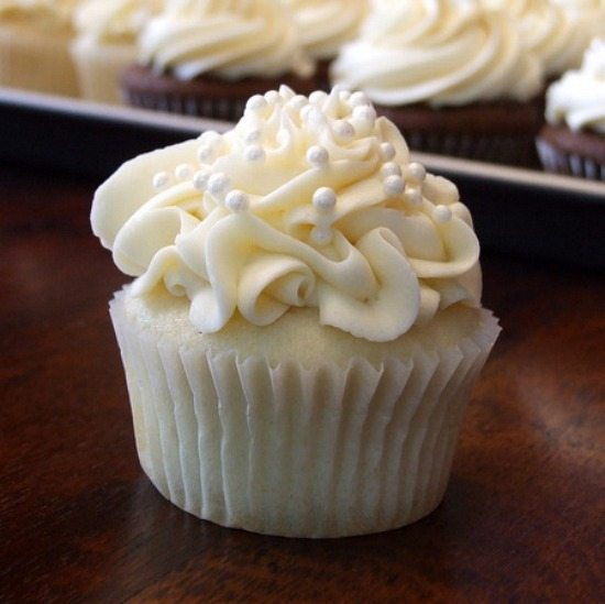 White Wedding Cupcake frosted with candied pearls on top
