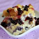 serving of blueberry french toast on a white plate with a purple napkin background