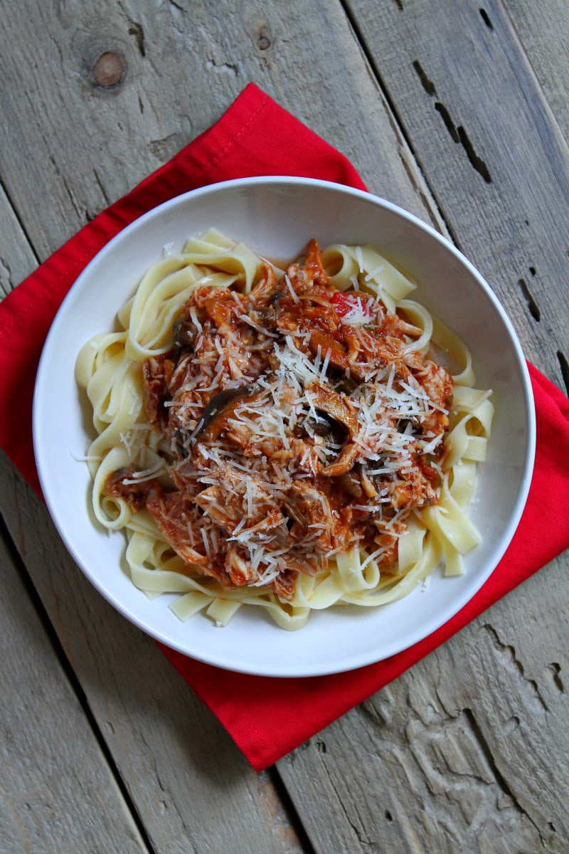 Slow Cooker Chicken Cacciatore served over noodles
