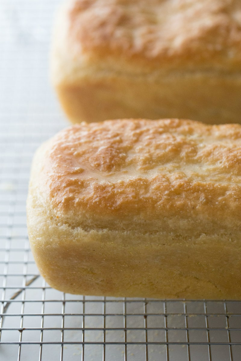 Two Loaves of English Muffin Bread on a cooling rack