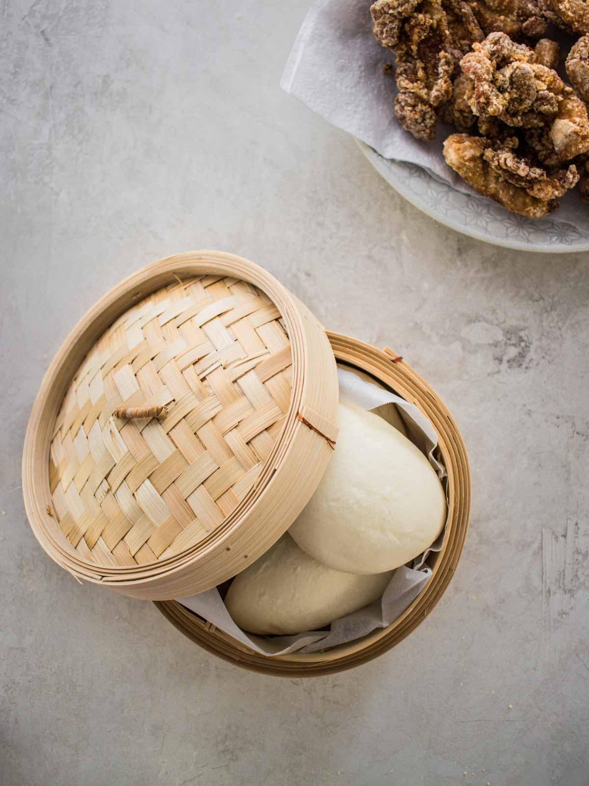 boa buns in a bamboo steamer