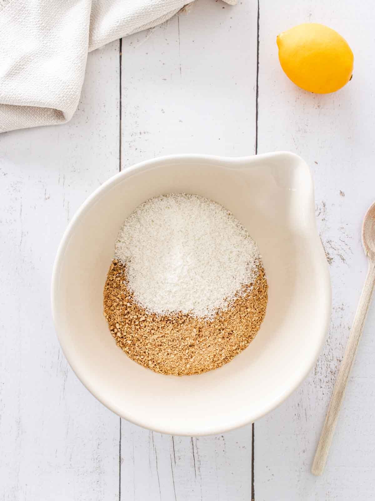 crushed biscuits and desiccated coconut in a bowl
