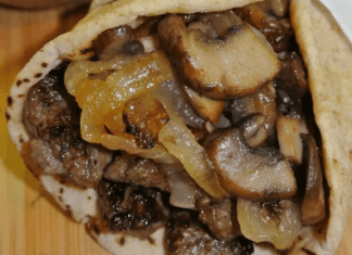 greek steak pita with caramelized onions and mushrooms