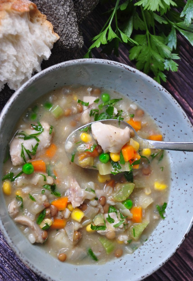 Hearty chicken, vegetable and lentil soup served with crusty bread