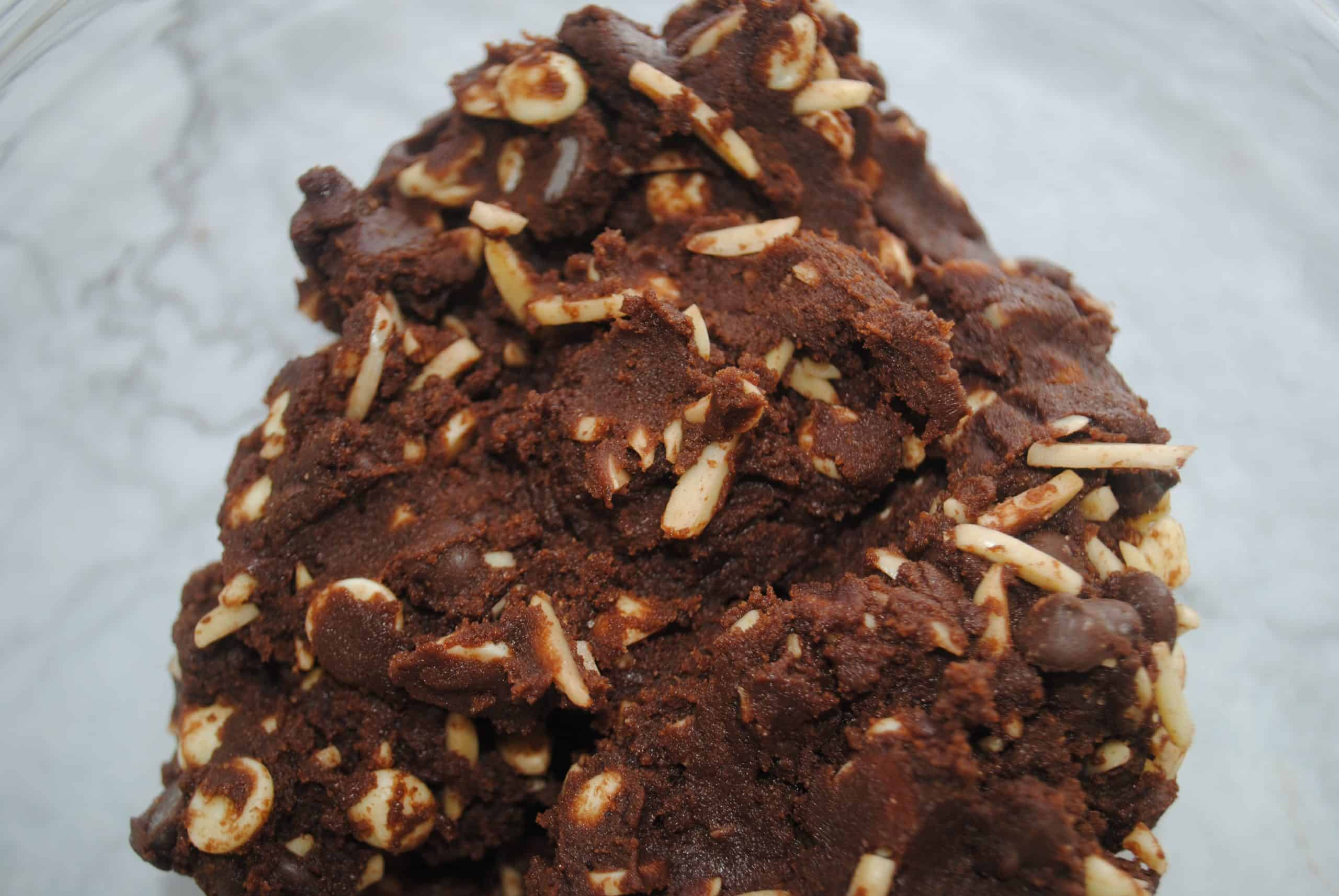 double chocolate almond cookies mixture with chocolate and almonds added ready to scoop