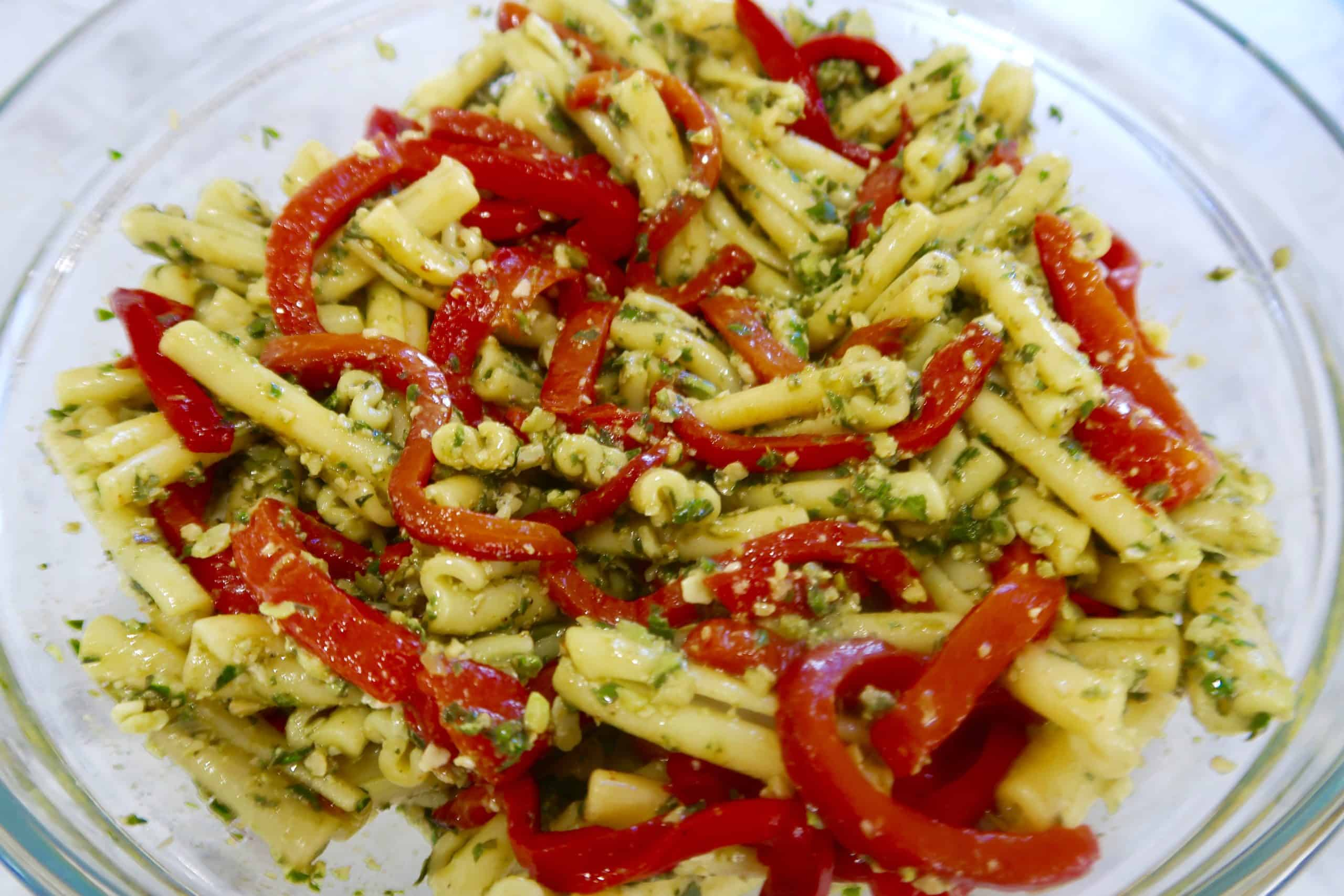 prawn, pesto and chargrilled capsicum pasta in white bowl