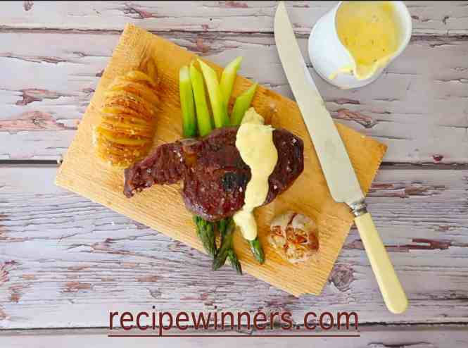 foolproof Bearnaise sauce served on a steak with asparagus and potato