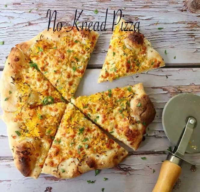 no knead pizza cooked on a wooden board sprinkled with parsley